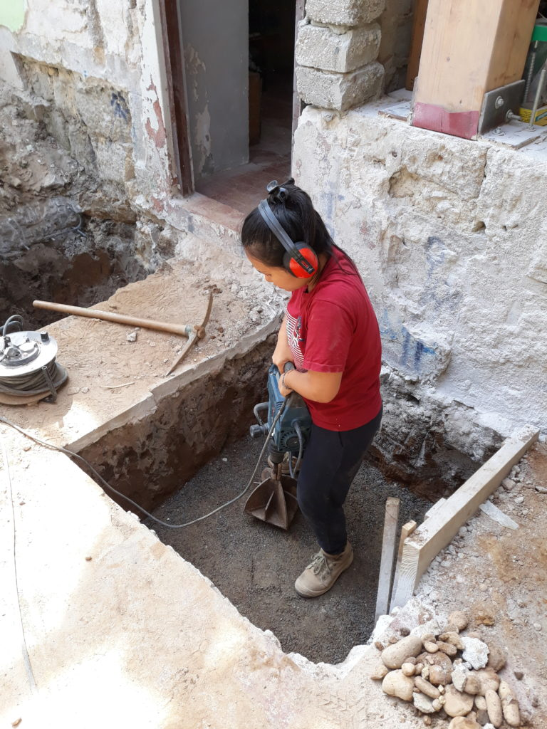 Woman levelling ground