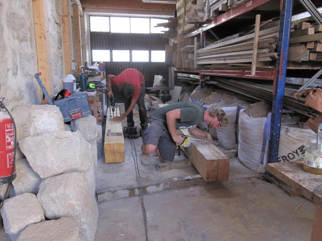 2 men working in workshop
